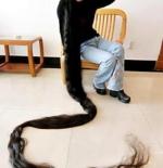 صورة صاحبة الشعر الطويل